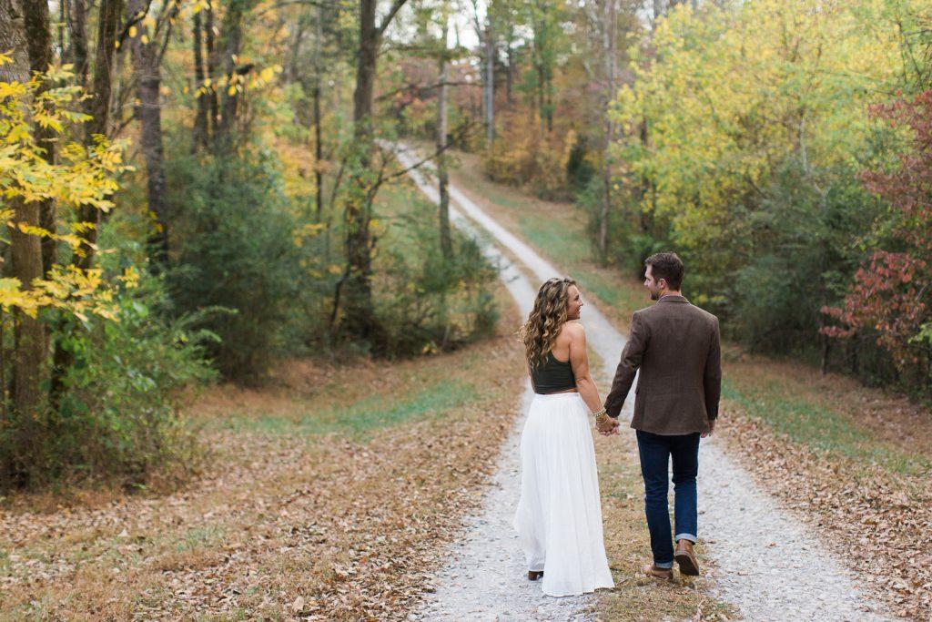 Couples walking in fall down street.