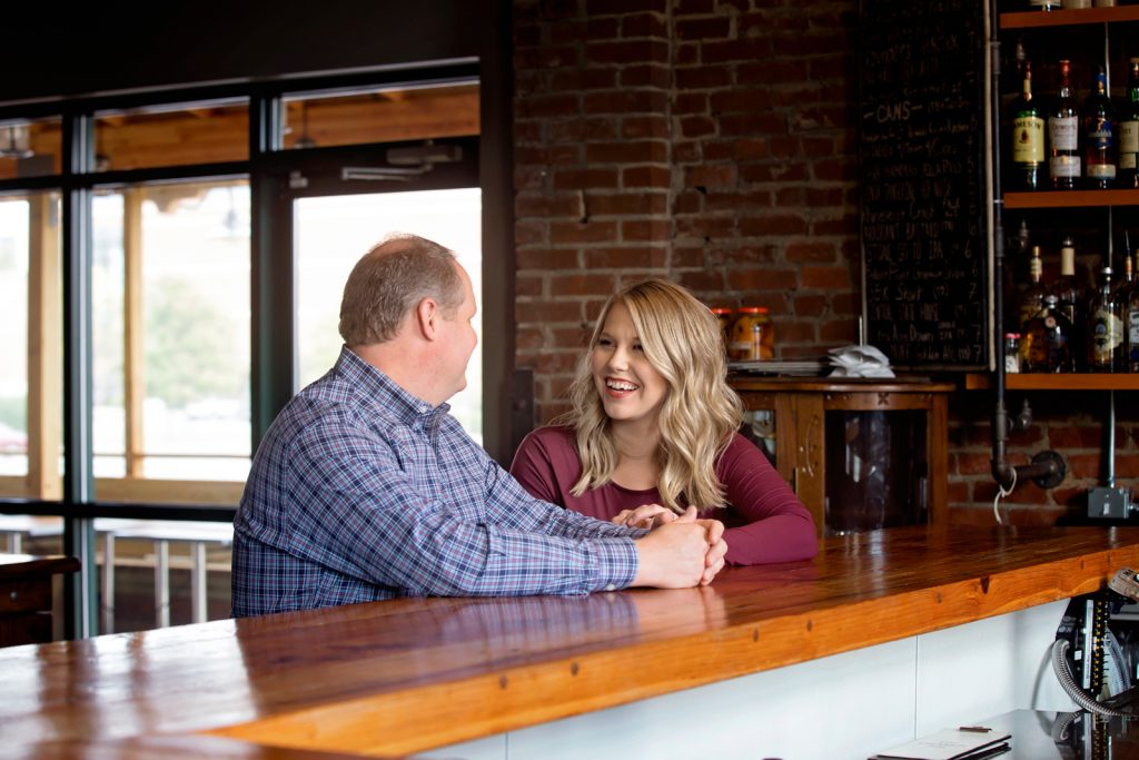Couple has drinks over dinner at bar.