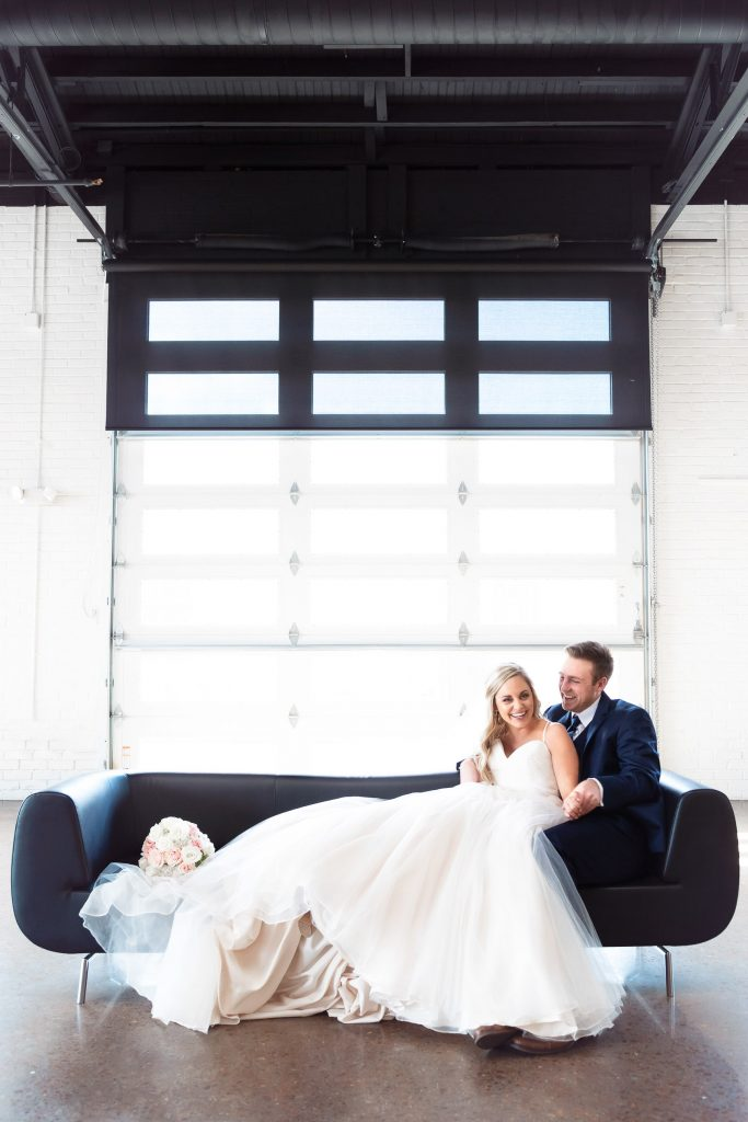 Couple on couch with modern doors.