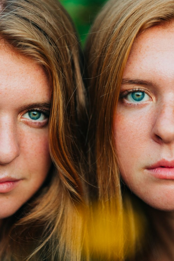 Twin girls with bold eyes.