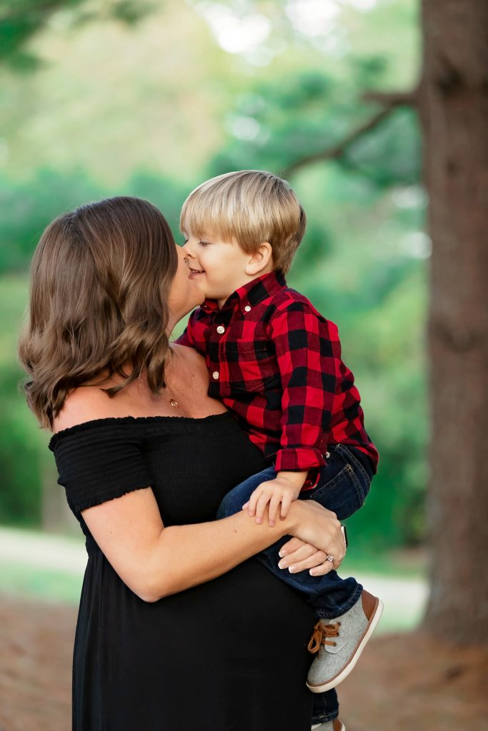 Mother and son kiss.