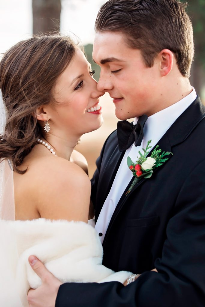 Newlyweds kiss after ceremony.