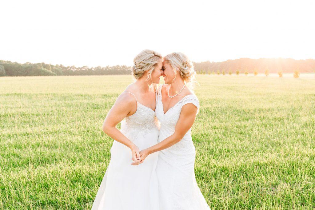 Couple dances in a field.