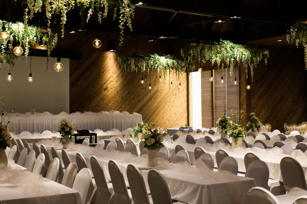 Reception venue with lights and wisteria