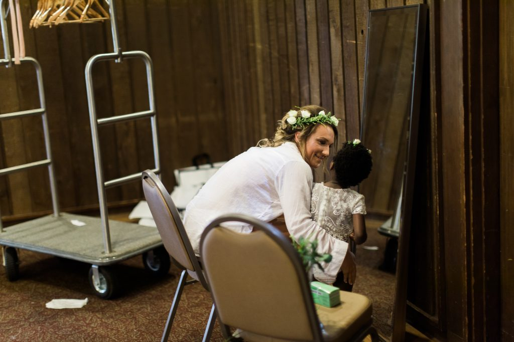 Bride getting ready with flower girl